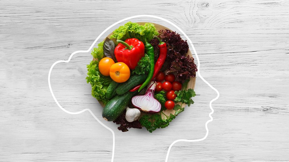 Outline of a womans head with vegetables inside (Credit: Getty Images)