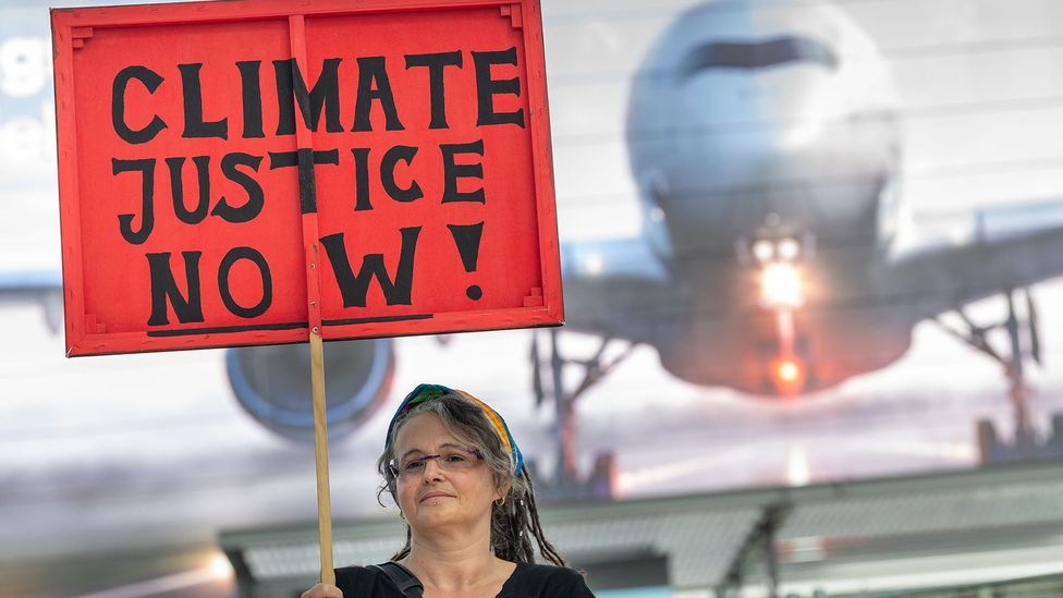 A climate justice protester in the Munich airport last July. More Germans are factoring environmental concerns into their travel plans (Credit: Getty Images)
