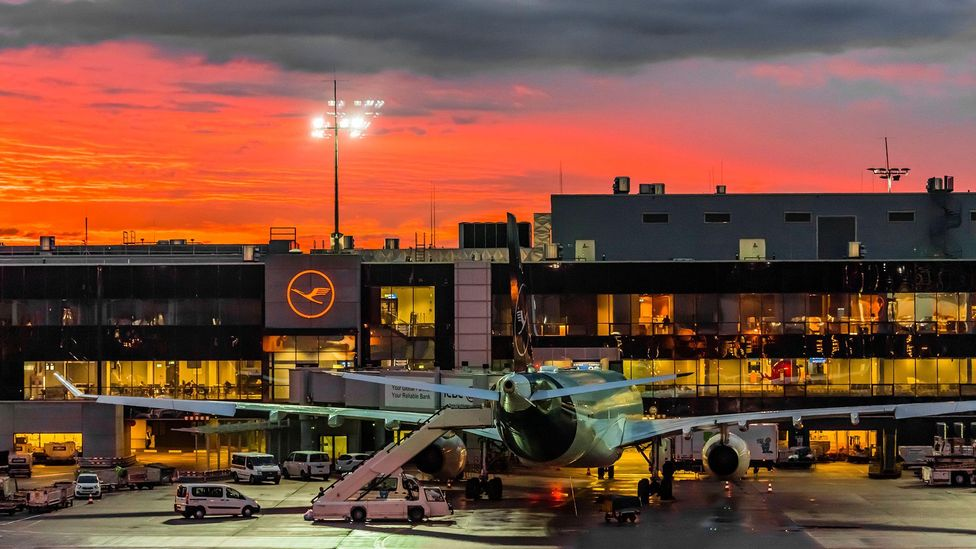 Sunrise at Frankfurt am Main Airport. Flight shaming has been a flashpoint for debate in Germany over the last year amid climate change concerns (Credit: Alamy)