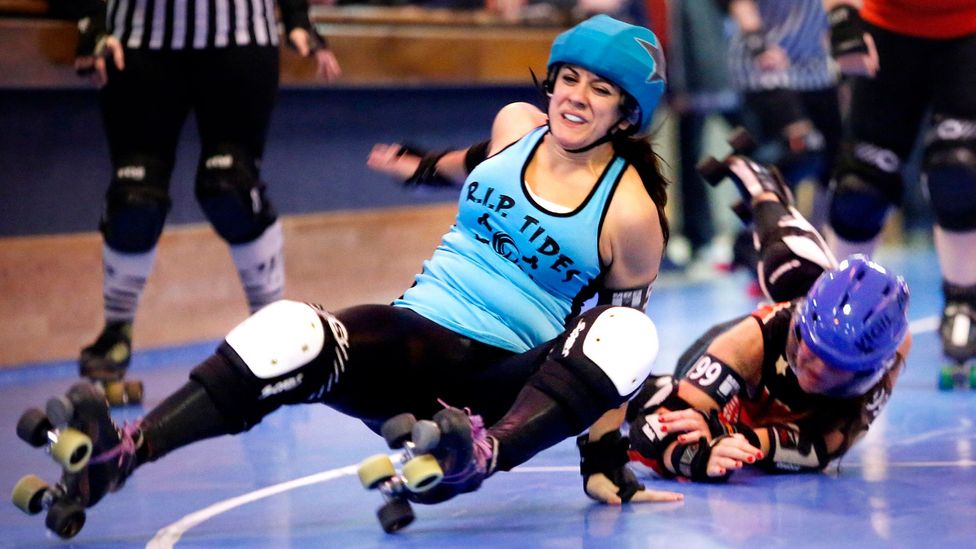 Despite the protective gear and helmets, collisions between skaters in roller derby can still lead to serious head injuries (Credit: Getty Images)