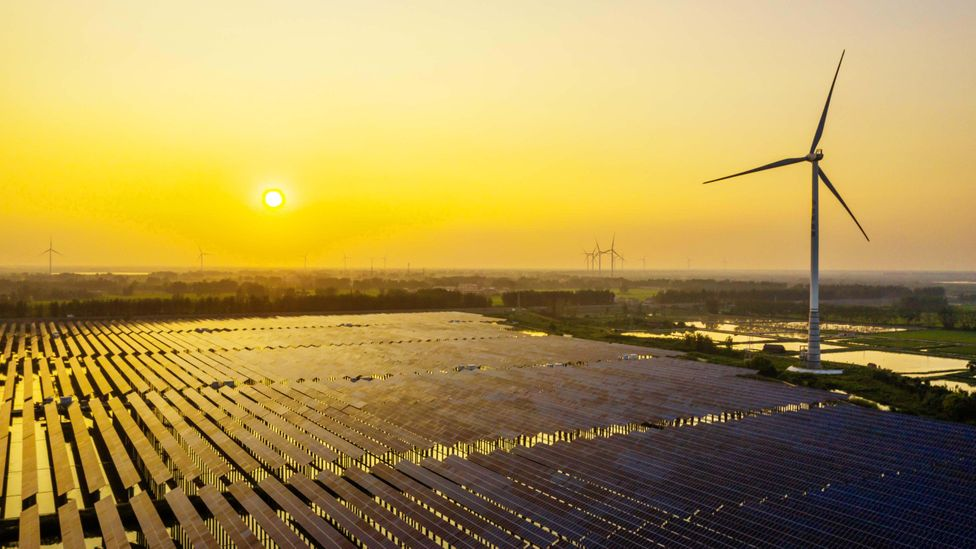A large scale shift from fossil fuels to renewable energy is the only real way to reduce the carbon emissions from our work (Credit: Getty Images)