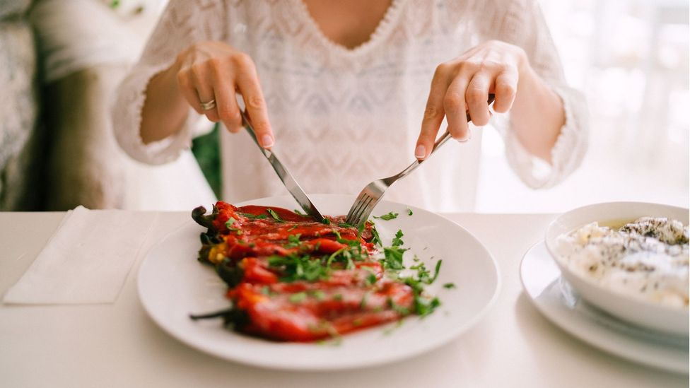 Woman eating roasted peppers (Credit: Getty Images)