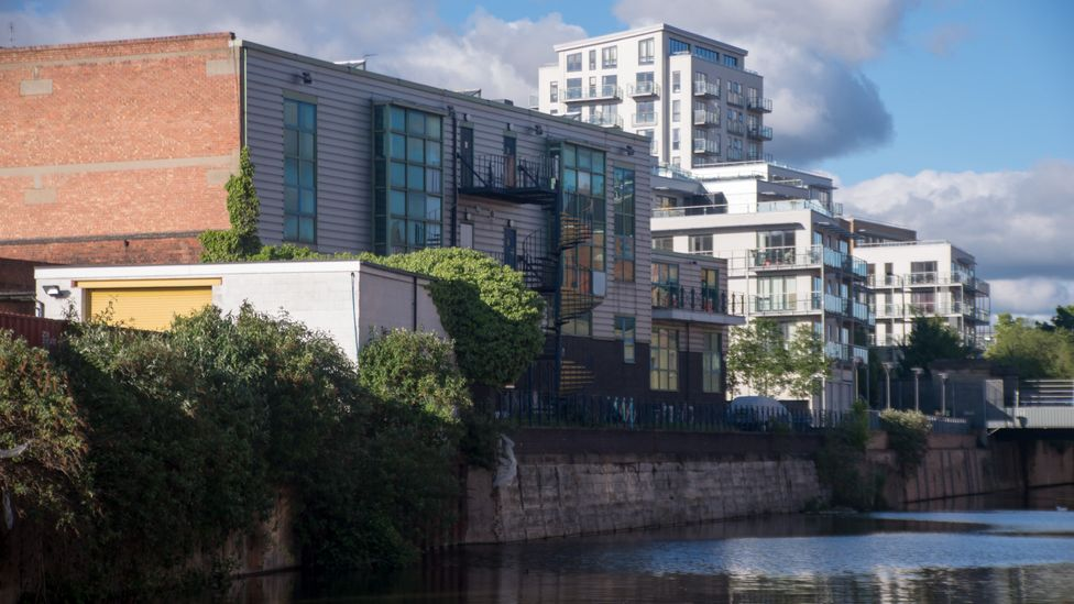Limehouse Cut in east London's Docklands area has many energy-efficient new-build houses, but its older housing is typically very inefficient (Credit: Getty Images)