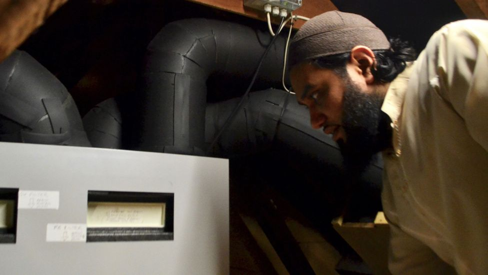 Saif Muhammad is taking part in a trial of a heating system designed to recycle warm rising air from inside houses back down to where it is useful (Credit: Laura Cole)