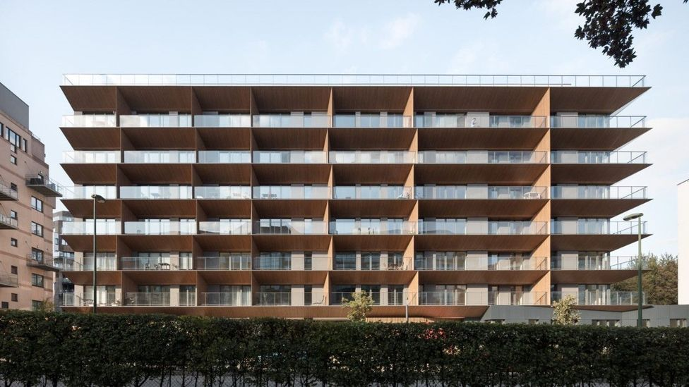 A building with unusually angled balconies can bump the internal temperature up by a few crucial degrees (Credit: A2M architects)