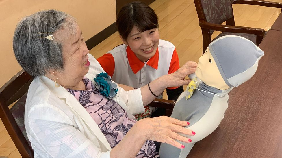 Critics call the Telenoid robot creepy, but government officials from around the world have visited this nursing home to see how it helps dementia patients (Credit: Bryan Lufkin)