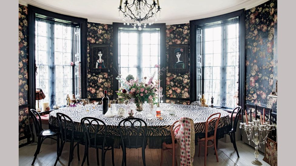 With its dark woodwork and wallpaper, Lowe's dining room has a romantic but edgy feel
