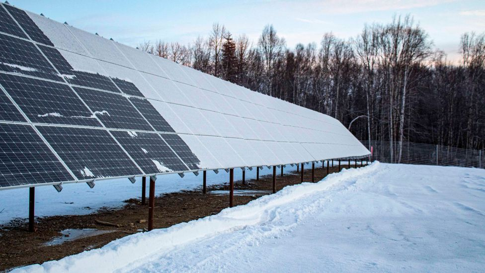 Snow covers half a large array of solar panels (Credit: Fischer Knapp)