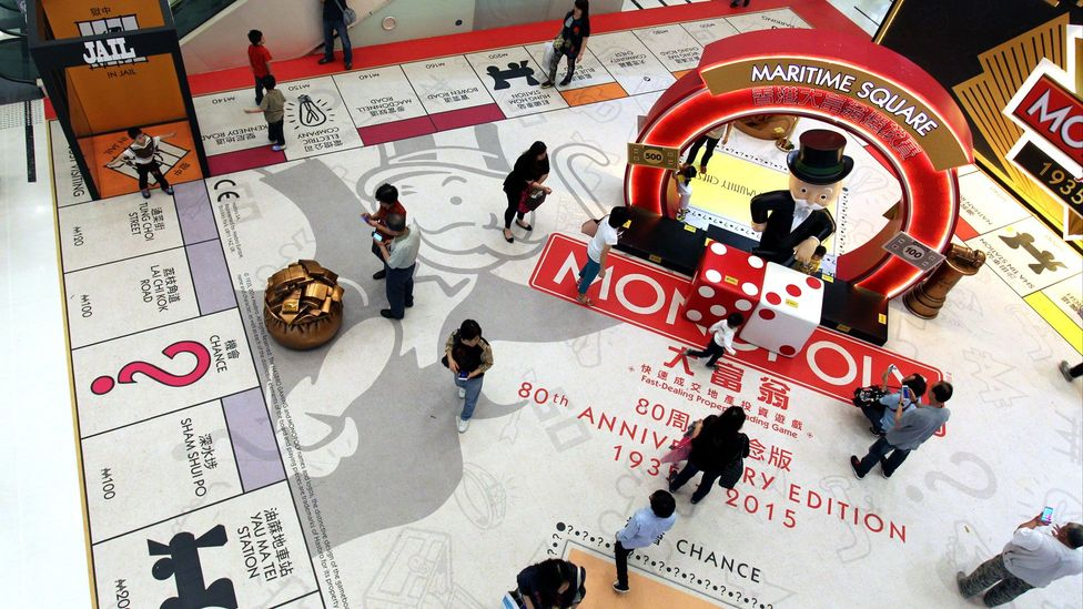 Shoppers in China walk over a giant version of the game which celebrates its 80th anniversary (Credit: Getty Images)