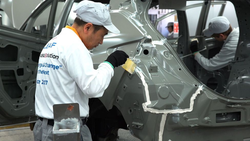 Yokohama-based car manufacturer Nissan employs craftsmen on their floor to do detailed work like apply sealant – and are teaching robots to do the same (Credit: Nissan)