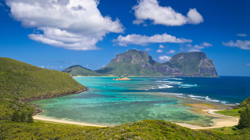Lord Howe Island hugs a turquoise lagoon rimmed with the world's southernmost coral reef (Credit: photosbyash/Getty Images)