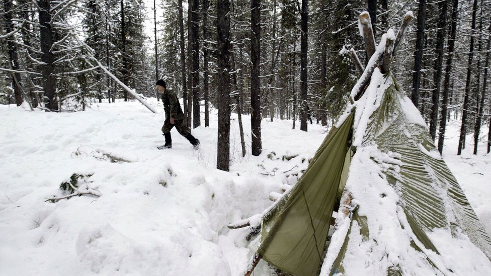 A soldier takes part in Sere training in Colville National Forest, Washington, on a freezing January morning (Credit: Getty Images)