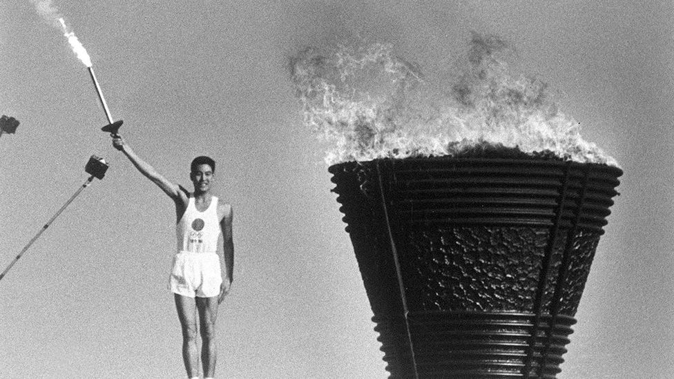 At the 1964 Tokyo Olympics, the Olympic flame - carried by Yoshinori Sakai - was a symbol of Japan's postwar reconstruction (credit: Alamy)
