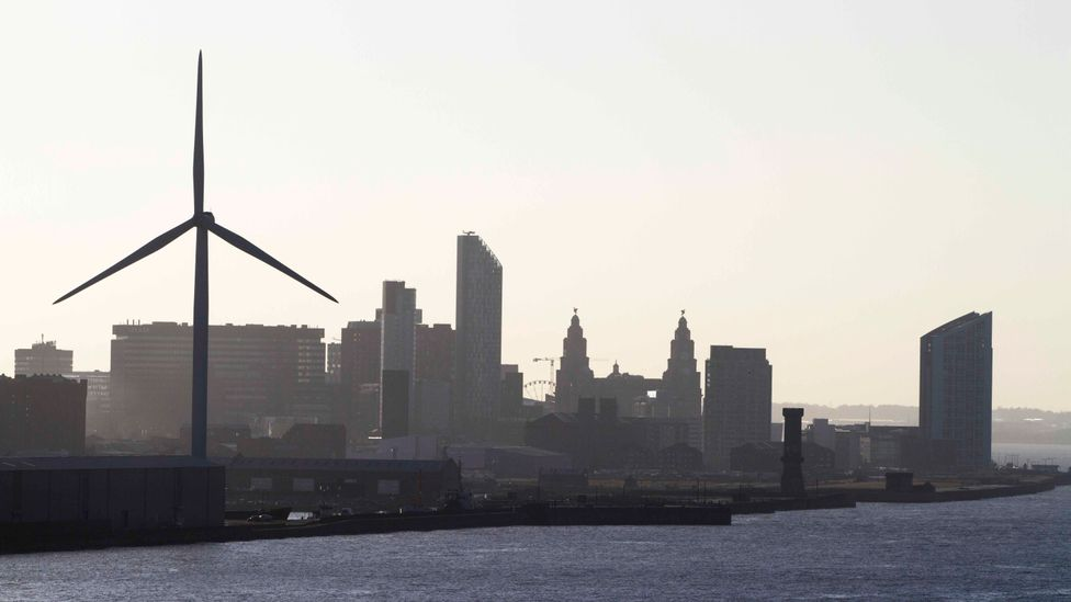 Constructing wind turbines close to urban centres, like this one by a dock in Liverpool in the UK, can reduce the impact of turbines on wildlife (Credit: Getty Images)