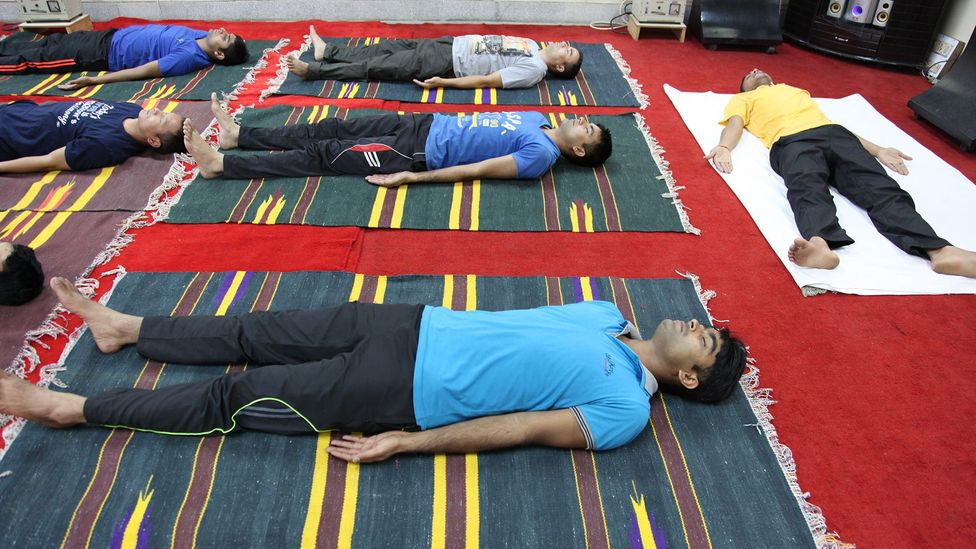 The science of yoga has often attracted research interest. Here, an Indian defence laboratory studies techniques to help soldiers in hostile environments (Credit: Getty Images)