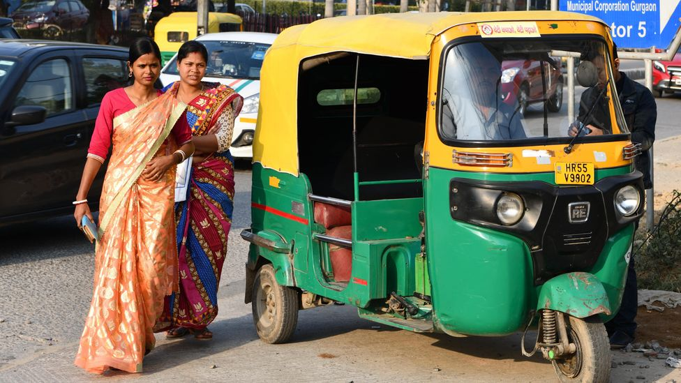 There are more than 1.5 million electric rickshaws in India already, but they are still far outnumbered by conventional auto-rickshaws (Credit: Getty Images)