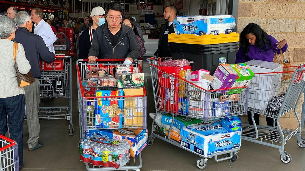 Customers in Los Angeles stock up on food, water and toilet paper on 29 February. Herd mentality is one of the key causes of panic buying (Credit: Getty Images)