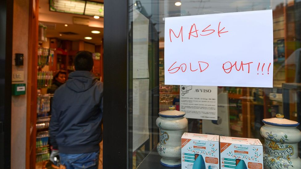 One of the ways panic buying backfires is that it depletes supply for goods needed by medical professionals, like this pharmacy selling face masks in Milan (Credit: Getty Images)