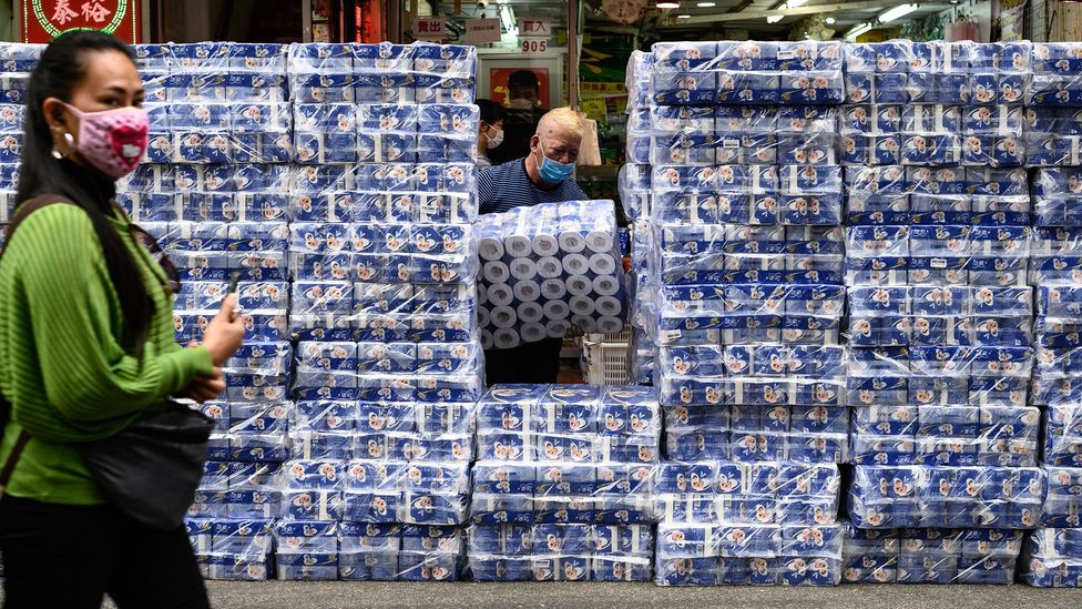 Stacks of toilet paper in Hong Kong on 8 February. From hand sanitiser to pasta and noodles, staples are flying off shelves in some stores (Credit: Getty Images)
