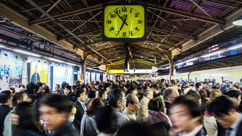 The daily hustle and bustle of life as a commuter is governed by the ticking of clocks, something that modern technology has made worse (Credit: Alamy)