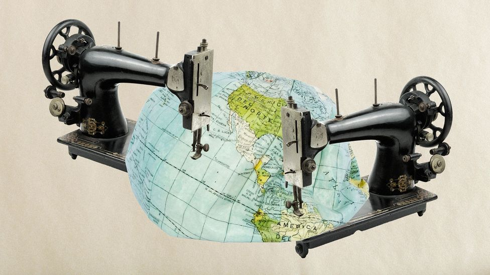 A map of the Earth being sewn by machines (Credit: Alamy/Javier Hirschfeld)