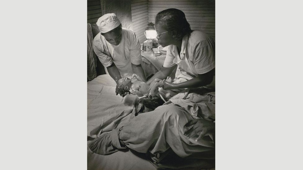 Midwife Maude Callen delivers a baby, Pineville, South Carolina, 1951 by W Eugene Smith (Credit: The Picture Collection Inc)