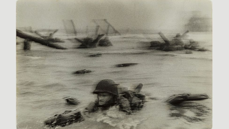 Normandy invasion on D-Day, soldier advancing through surf, 1944 by Robert Capa