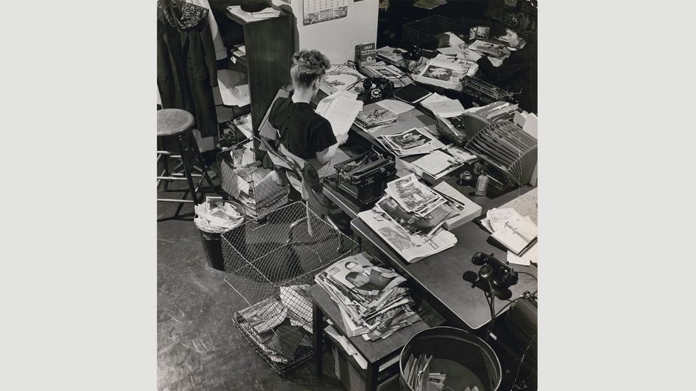 Life photo editor Natalie Kosek reviews photographs, 1946 by unknown photographer (Credit: The Picture Collection Inc)