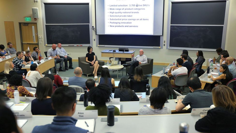 Former Costco CEO James Sinegal speaks to students in an operations management class at the MIT Sloan School of Management. (Credit: Getty Images)