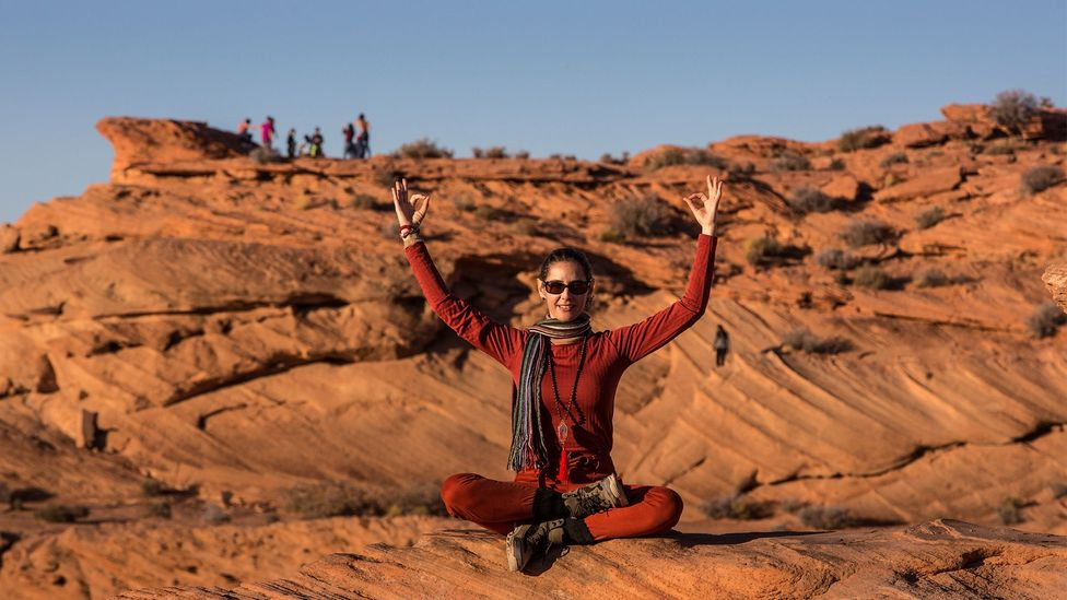 Workcations create social distancing by giving you solitary time in nature, and involve scheduled physical activities such as yoga or skiing. (Credit: Getty Images)