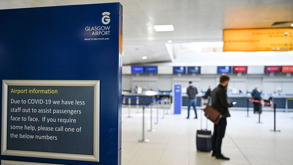 Glasgow Airport is quiet with empty check in desks (Credit: Jeff J Mitchell/Getty Images)