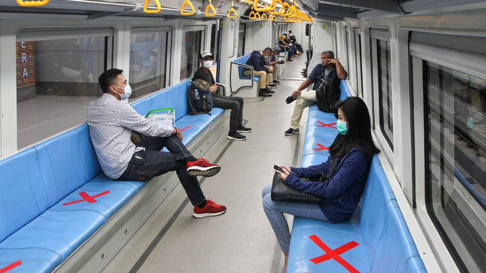 In Palembang, South Sumatra, seats on trains have been marked with red crosses to show people how to keep their distance (Credit: Getty Images)