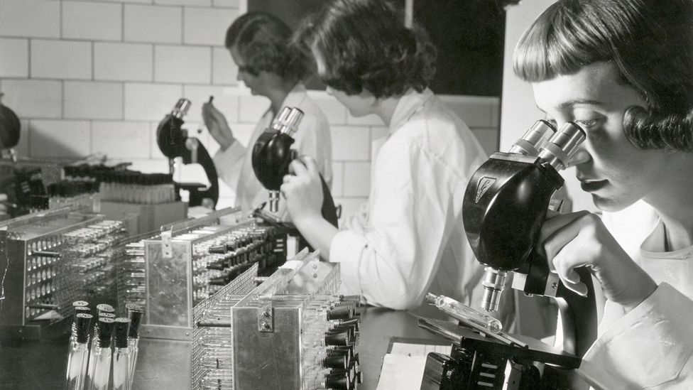 The polio vaccine, shown here studied by scientists in the 1950s, eliminated, in most of the world, a disease in that used to kill or disable millions (Credit: Getty Images)