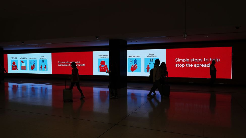 Warnings greet travellers at Sydney International Airport. From Wednesday 25 March, all international travel to Australia was banned (Credit: Getty Images)