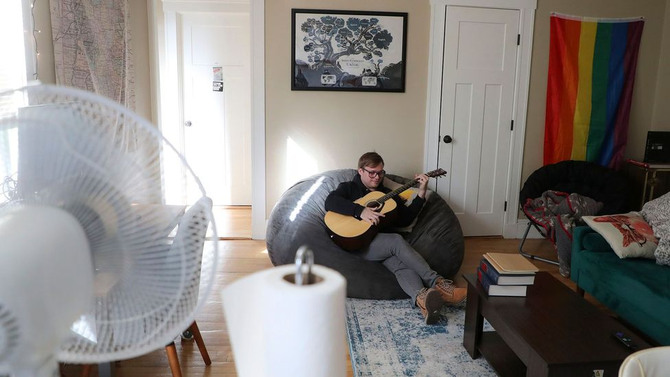 A law student in Boston takes up guitar while in quarantine. Experts say new hobbies can help some, but such messaging may be anxiety-inducing for others (Credit: Getty Images)