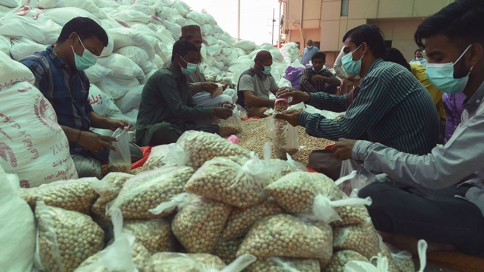 """Amid the pandemic, many Pakistanis are offering a Muslim charity tax called """"zakat"""" to help those eat who can no longer work (Credit: Asif Hassan/Getty Images)"""