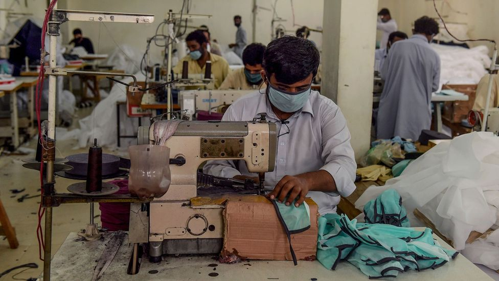 As many places shut down in Pakistan, some workers have begun making protective masks for the public (Credit: Asif Hassan/Getty Images)