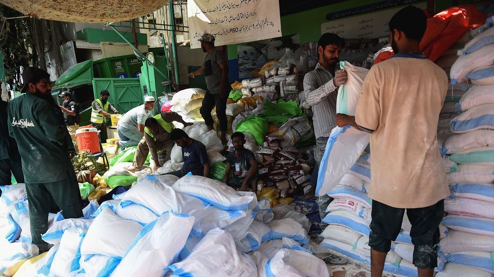 Many zakat donations go towards creating monthly ration packets that provide daily wage earners basic grocery items (Credit: Rizwan Tabassum/Getty Images)