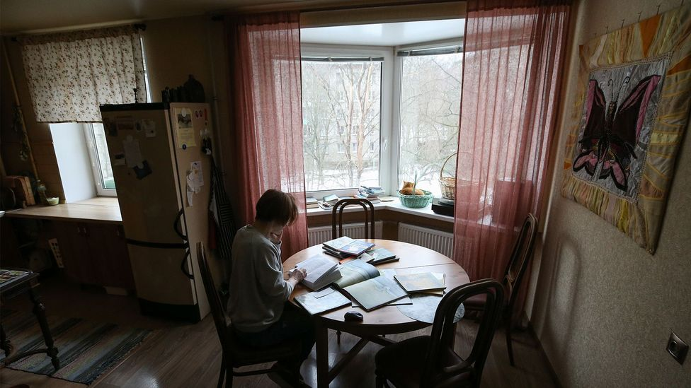 Veronika Makarova reads fairy tales to children on the phone, working from her apartment during the Covid-19 pandemic (Credit: Getty Images)