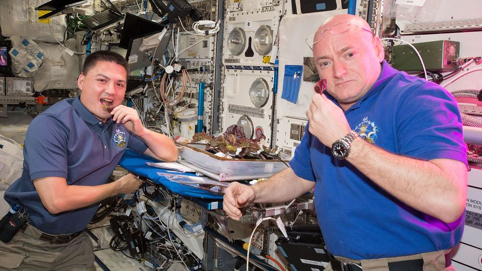 Kjell Lindgren (left) says mealtimes were an important time to reconnect with other crew members on the ISS (Credit: Nasa/Getty Images)