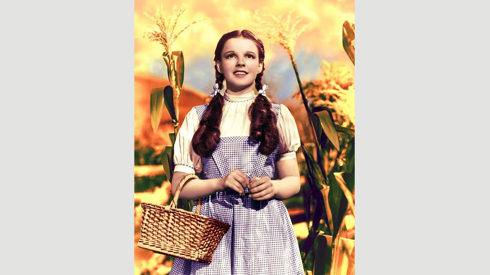 After Aunt Em tells Dorothy to find 'a place where you won't get into any trouble' in The Wizard of Oz, the girl (played by Judy Garland) sings Over the Rainbow (Credit: Alamy)