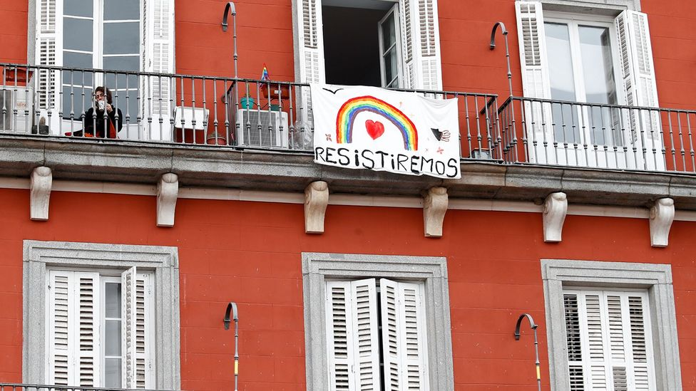 A rainbow banner that says 'We will resist' hangs on a balcony in Madrid (Credit: Óscar J Barroso/Europa Press via Getty Images)