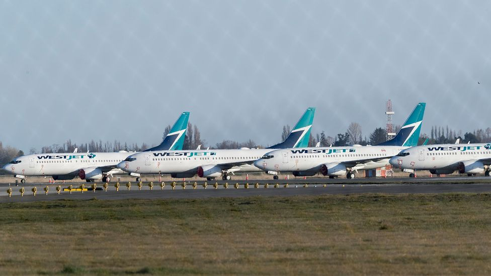 Planes, from Canada's second largest airline Westjet, sit grounded at Vancouver International Airport on April 09, 2020 in British Columbia, Canada (Credit: Getty Images)