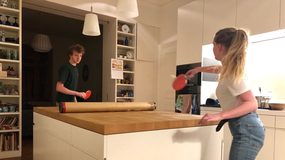 Sarah Holland's family plays ping pong on their kitchen worktop (Credit: Sarah Holland)