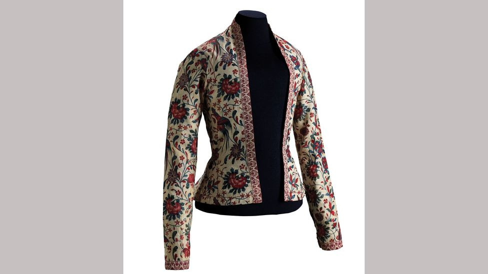 The textile for this jacket was hand-drawn and dyed in southeast India in the 18th Century, then tailored in Europe