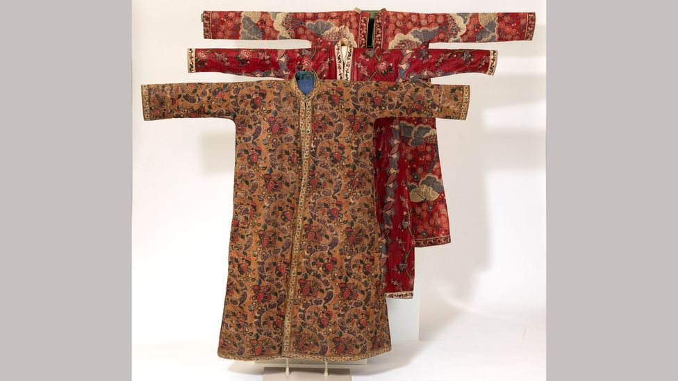 These men's banyans made of Indian chintz are glazed brown, and were created around 1765