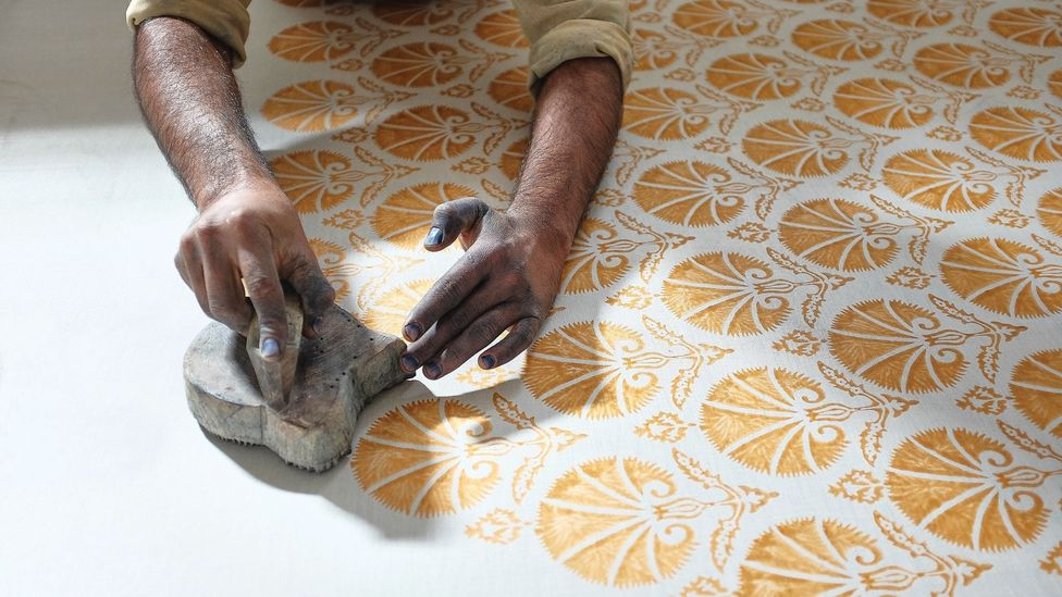 Carved wooden blocks are used to apply the dyes and the mordant to textiles