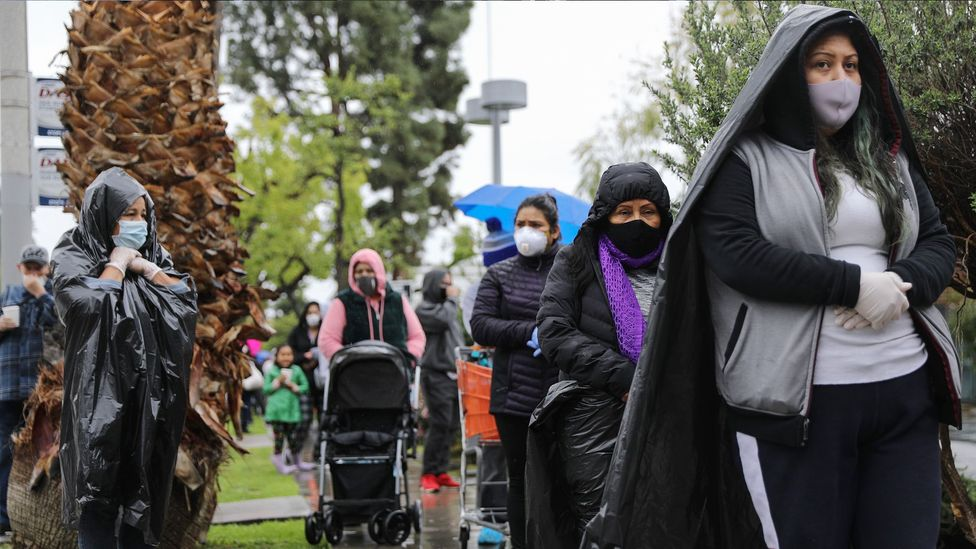 People wait in line at a food bank in Van Nuys, California, where organisers said they had distributed food for 1,500 families amid the spread of Covid-19 (Credit: Getty Images)