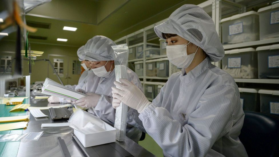 Workers prepare components for testing kits in South Korea in March 2020; getting enough supplies for testing has been a challenge for many countries (Credit: Getty Images)
