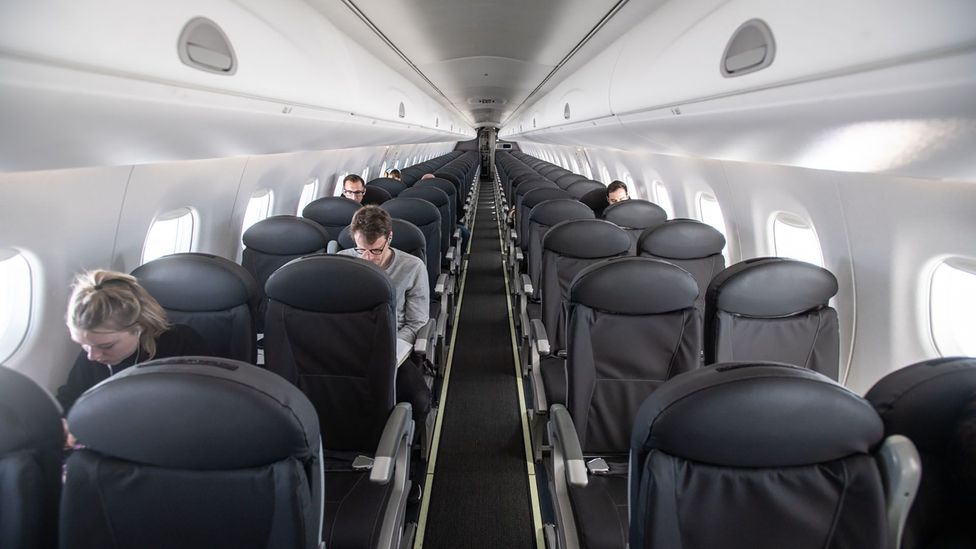 An almost empty flight from Milan to London in March. Some airlines are moving to keep at least middle seats empty in aircraft that have them (Credit: Getty Images)